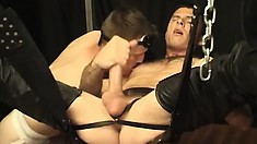 Submissive slave gets his ass fucked balls deep by a leather daddy