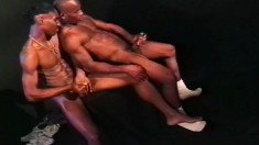 Two black guys with ripped bodies stroke their dicks and cum together